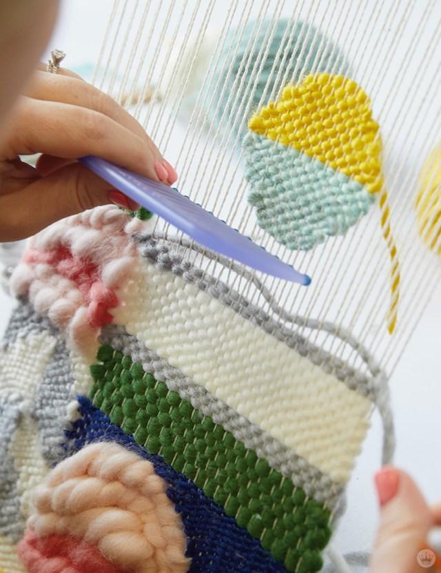 Weaving workshop: hallmark artist weaves around shapes on small loom