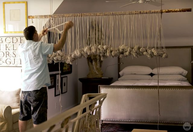 Andy N. works on a macrame wall hanging