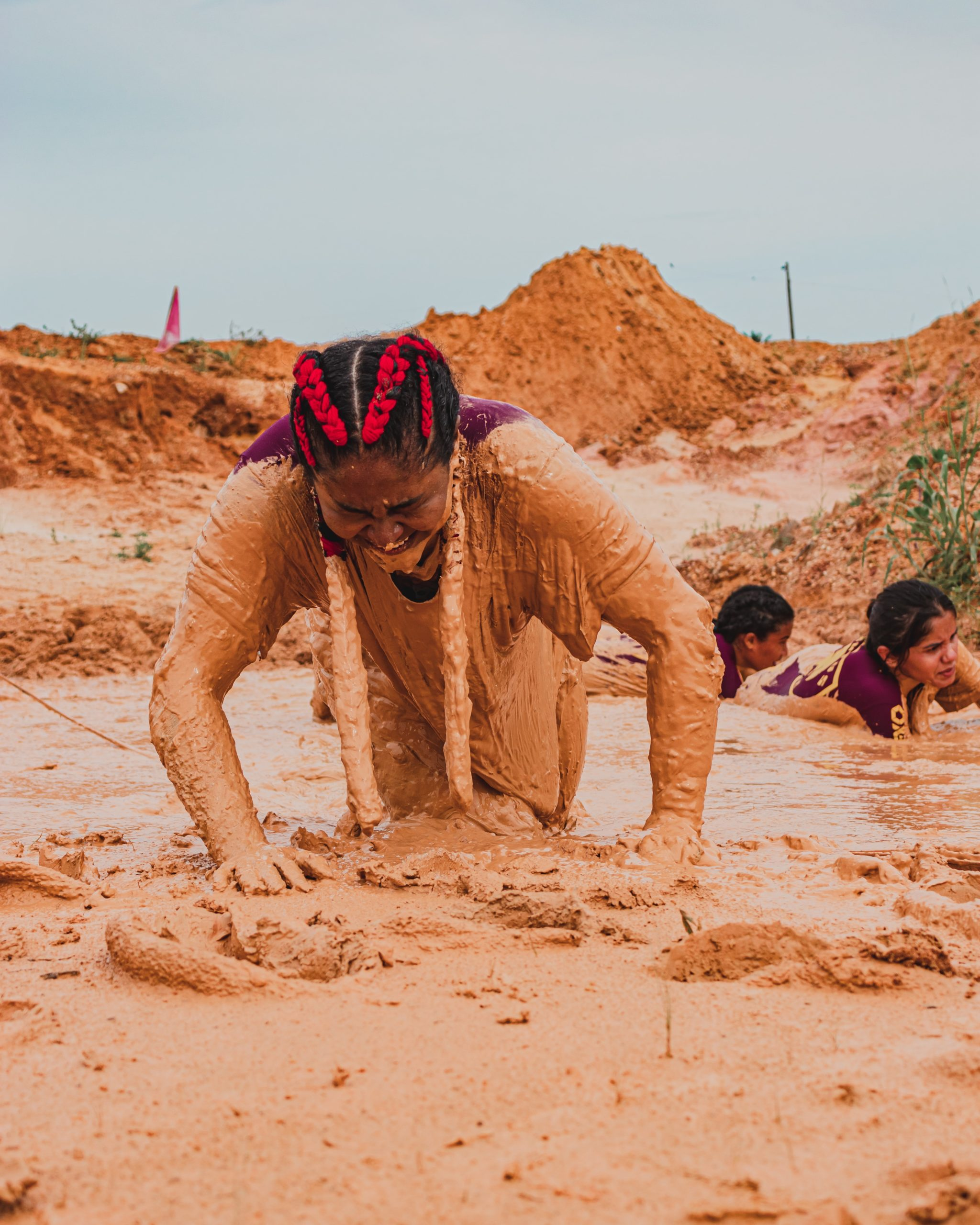 Woman crawling through mud
