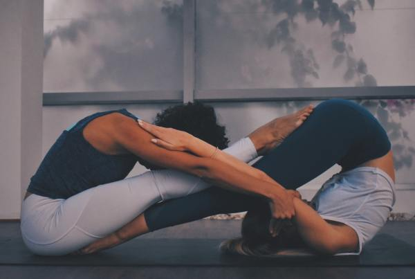 Two women in a yin and yang pose