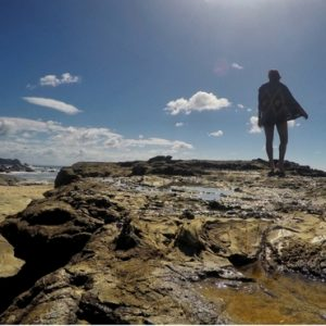 Image of me on the rocky shore of Playa Maderas, Nicaragua.