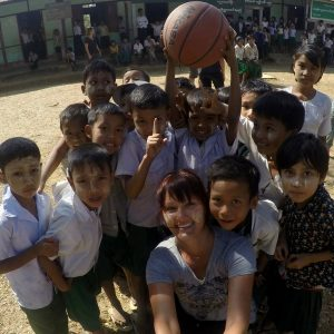 Image of me with children playing in the schoolyard in a remote village in Myanmar.