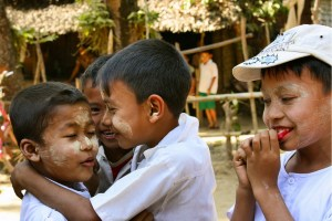 Image of children laughing and giggling during our visit to a remote village in Myanmar.