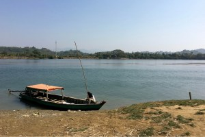 Image of our longboat which took us up a river from Ngapali Beach to a remote village in Myanmar.