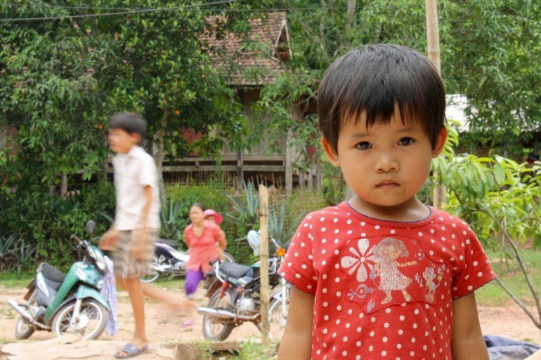 Image of a hesitant young girl in Xom Pung Village Vietnam.