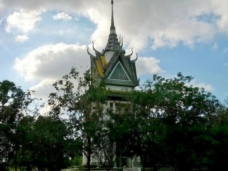 Image of a Buddhist stupa now built as a memorial on the Killing Fields where thousands died in a mass grave in Cambodia.