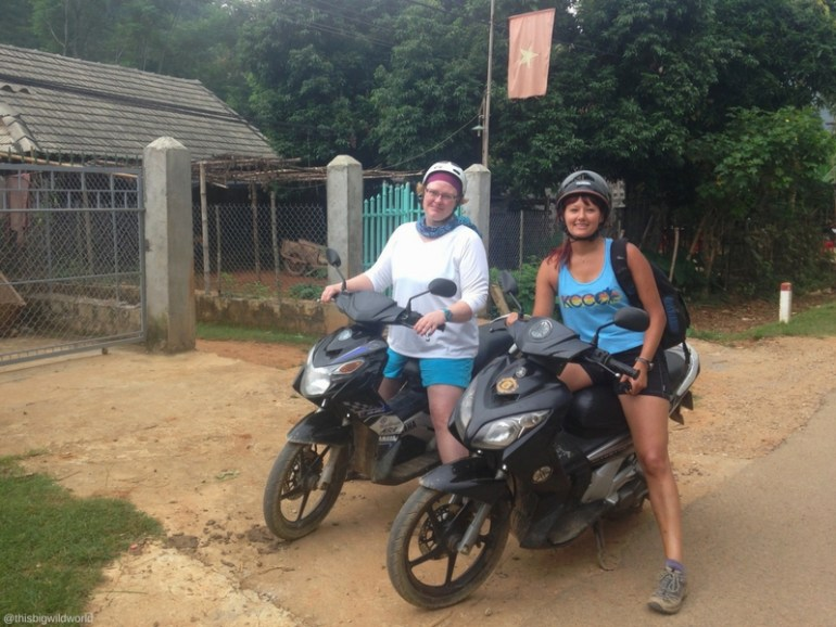 Image of me and my cousin taking a break on the side of the road while scootering in Vietnam.