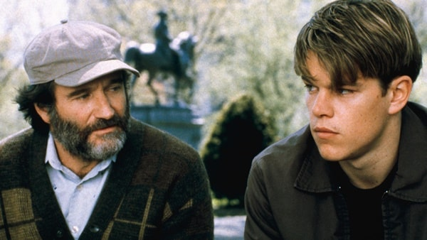 Will Hunting, one of the 6 iconic Matt Damon roles, and Sean Maguire on a bench.
