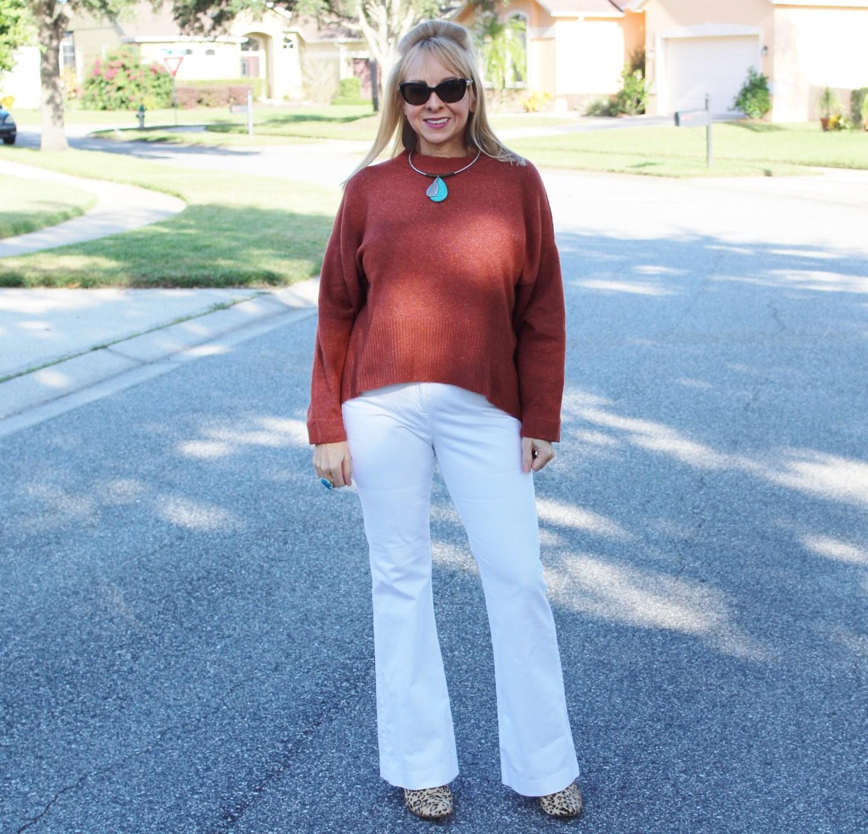 Rust sweater + white slacks