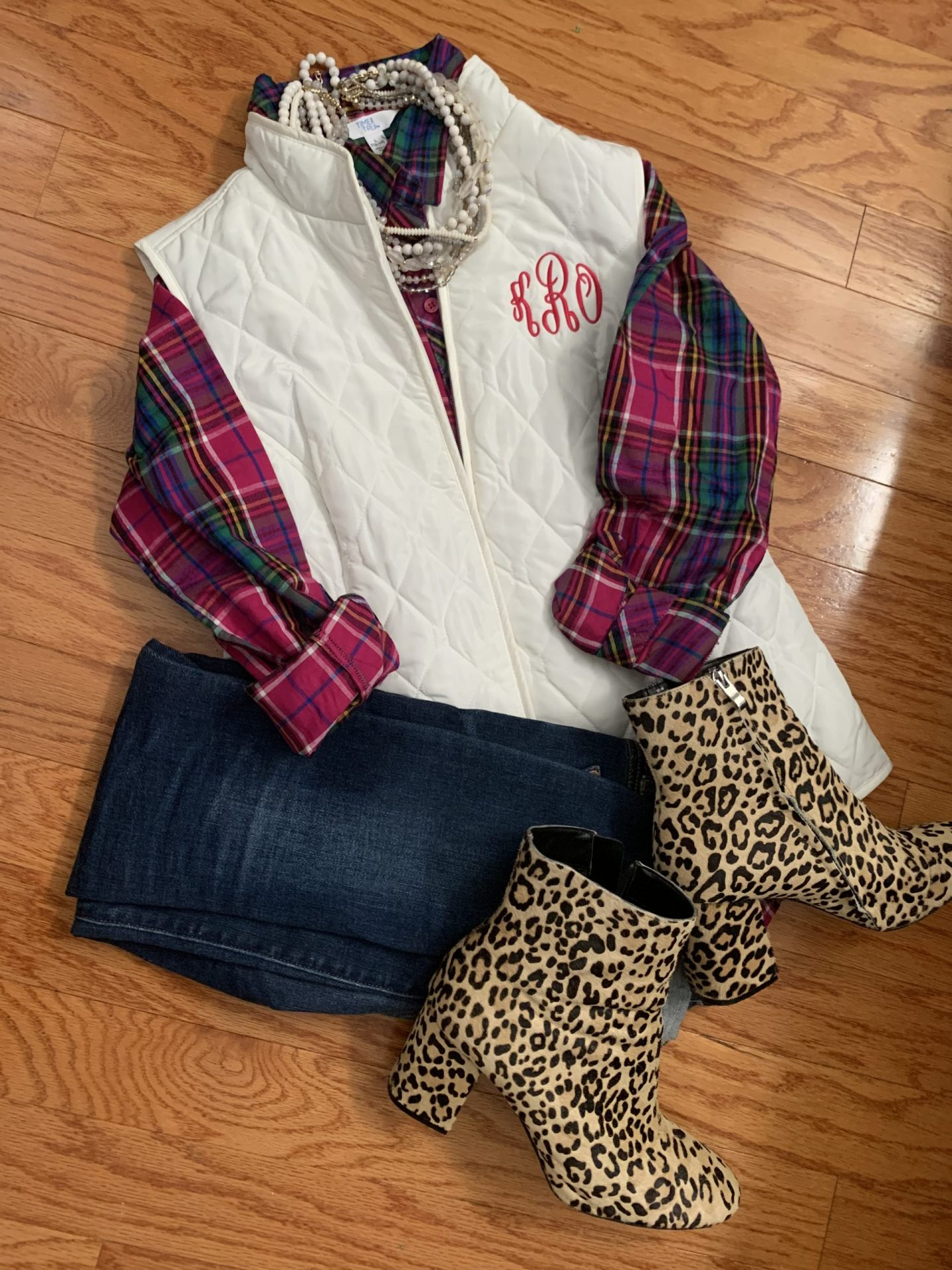 Plaid shirt + Vest + Jeans + Leopard Booties