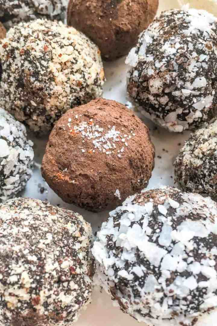 closeup photo of chocolate hazelnut balls dusted with cocoa powder