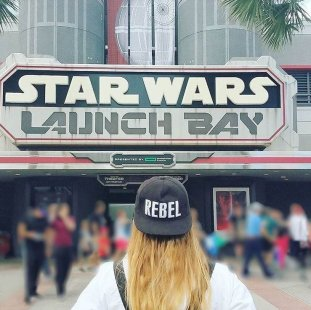 "Girl wearing ""Rebel"" hat in front of Star Wars Launch Bay at Disney's Hollywood Studios"