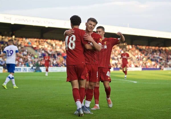 BIRKENHEAD, ENGLAND - Thursday, July 11, 2019: Liverpool's Curtis Jones (L) celebrates scoring the fourth goal with team-mate Bobby Duncan during a pre-season friendly match between Tranmere Rovers FC and Liverpool FC at Prenton Park. (Pic by David Rawcliffe/Propaganda)