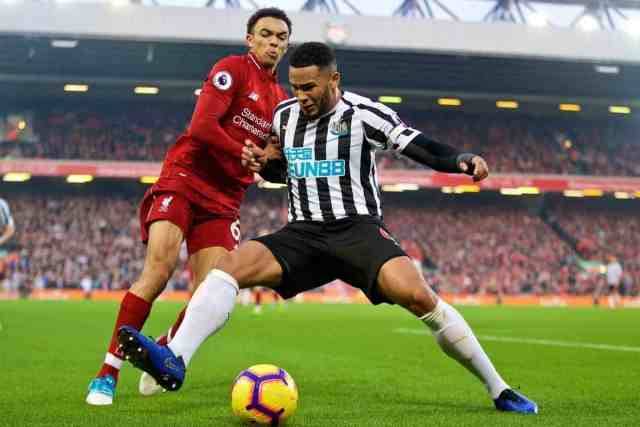 LIVERPOOL, ENGLAND - Boxing Day, Wednesday, December 26, 2018: Liverpool's Trent Alexander-Arnold (L) and Newcastle United's captain Jamaal Lascelles during the FA Premier League match between Liverpool FC and Newcastle United FC at Anfield. (Pic by David Rawcliffe/Propaganda)