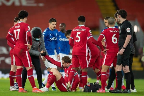 LIVERPOOL, ENGLAND - Saturday, February 20, 2021: Liverpool's captain Jordan Henderson goes down injured during the FA Premier League match between Liverpool FC and Everton FC, the 238th Merseyside Derby, at Anfield. (Pic by David Rawcliffe/Propaganda)