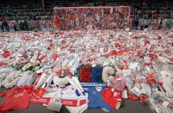 April 17, 1989, floral tributes are placed by soccer fans at the 'Kop' end of Anfield Stadium in Liverpool, England, on April 17, 1989, after the Hillsborough April 15 tragedy when fans surged forward during the Cup semi-final between Liverpool and Nottingham Forest at Hillsborough Stadium killing 96 people. (Picture by: Peter Kemp / AP/Press Association Images)