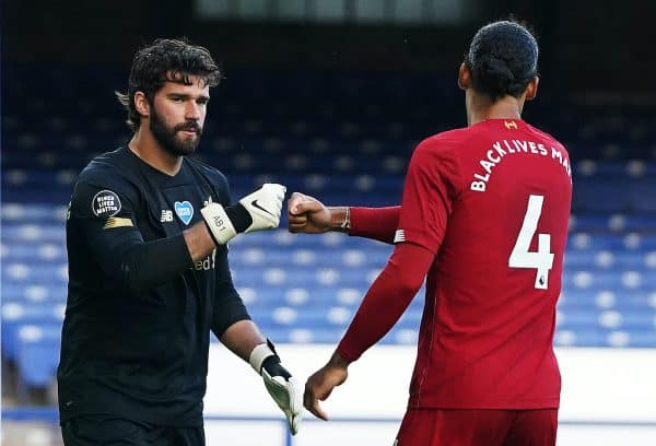 Liverpool goalkeeper Alisson fist bumps Virgil van Dijk during the Premier League match at Goodison Park, Liverpool. (Jon Super/NMC Pool/PA Wire/PA Images)