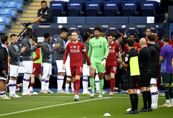 Manchester City form a guard of honour for newly crowned Premier League Champions Liverpool before the Premier League match at the Etihad Stadium, Manchester. PA Photo. Issue date: Thursday July 2, 2020. See PA story SOCCER Man City.{Image: Peter Powell/NMC Pool/PA Wire.)