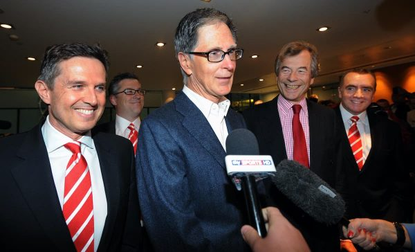Liverpool FC new owner John W Henry (centre) of NESV with Liverpool chairman Martin Broughton (2nd right) and the club's managing director Christian Purslow (left) at the offices of Slaughter and May in the City of London today.