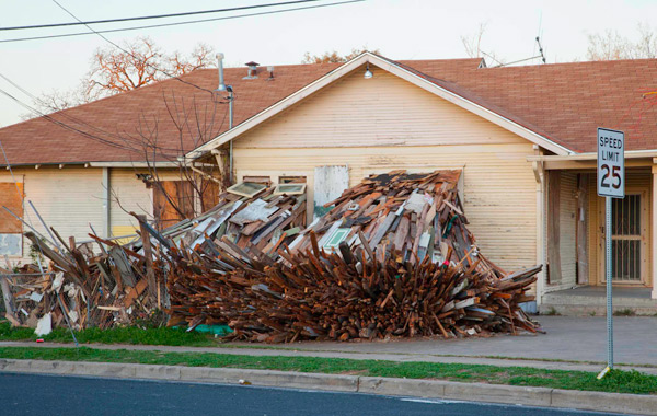 A Condemned House Explodes Onto the Streets of Austin wood installation Austin art architecture