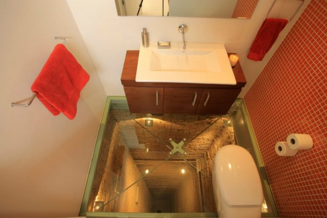 A Bathroom Situated Atop a 15 Story Elevator Shaft interior design bathrooms architecture