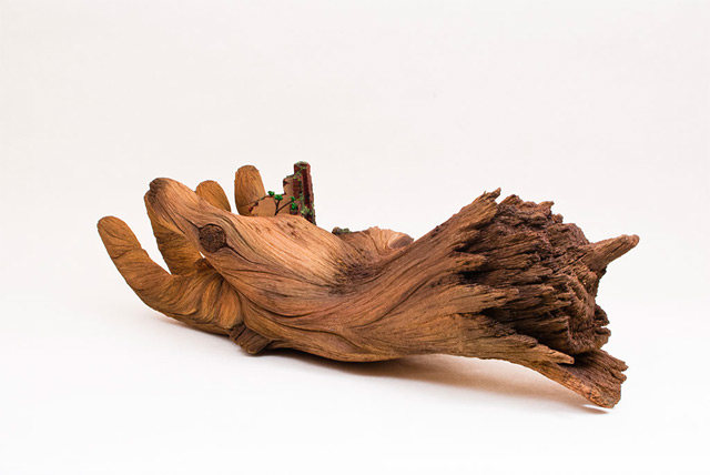 Cycle of Decay: A Sculpted Ceramic Hand that Looks Like a Carved Tree Branch wood sculpture ceramic anatomy