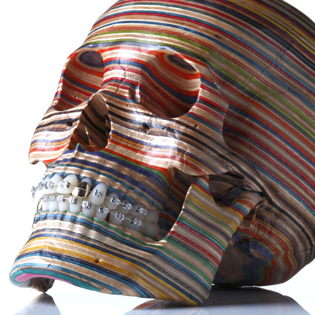 A Skull Made from Repurposed Skateboard Decks by Haroshi wood skulls sculpture anatomy