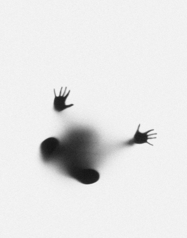 Ghostly Hands and Feet Photographed Through Milk Glass by Marek Chaloupka silhouettes black and white