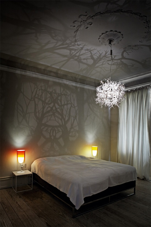 A Chandelier that Projects Tree Shadows trees shadows lighting