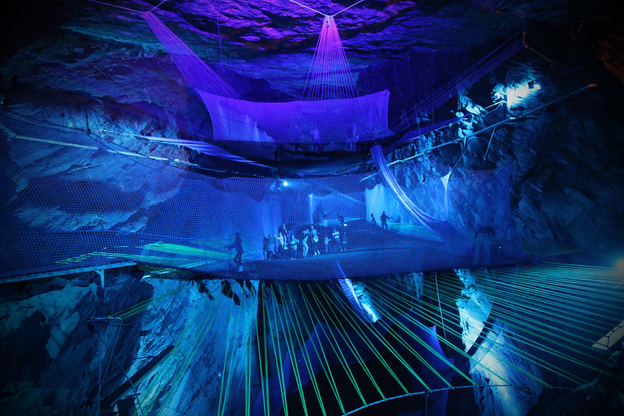 Bounce Below: A Giant Network of Trampolines Suspended in an Abandoned Welsh Slate Mine trampolines playgrounds caves