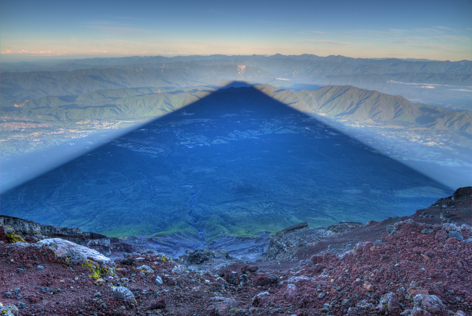 Photographer Captures Perfect Shadow of Mt. Fuji at Sunrise shadows Mt. Fuji mountains Japan
