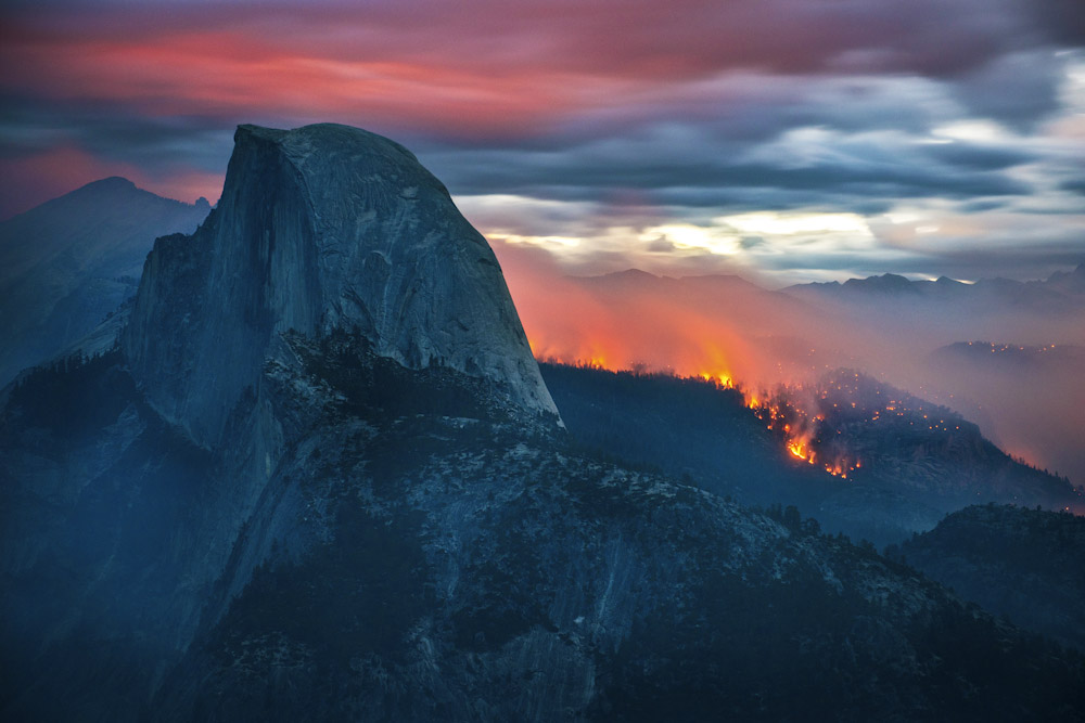 The Meadow Fire burns overnight near Half Dome in Yosemite National Park early Monday September 8, 2014. As of Wednesday the fire had burned over 4,500 acres and was 10% contained.  Long exposure image.