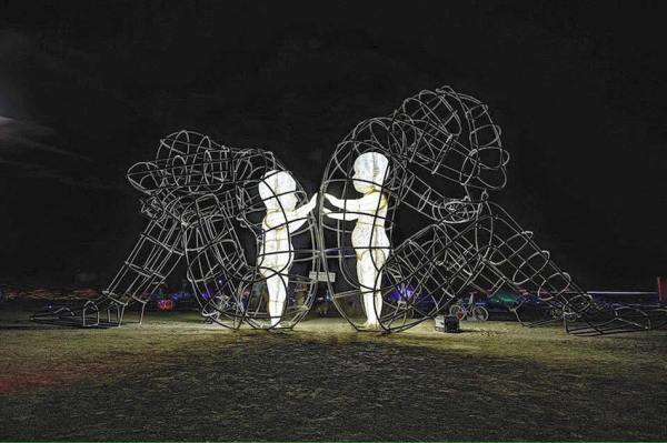 Large Wire-Frame Sculpture Shows the Glowing Forms of ...