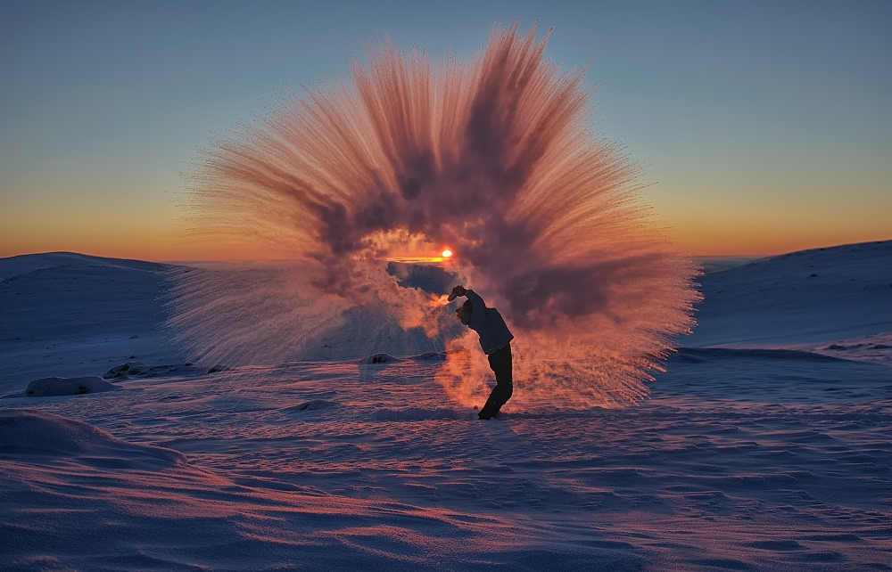 A picture of Frozen tea being thrown in the Arctic circle