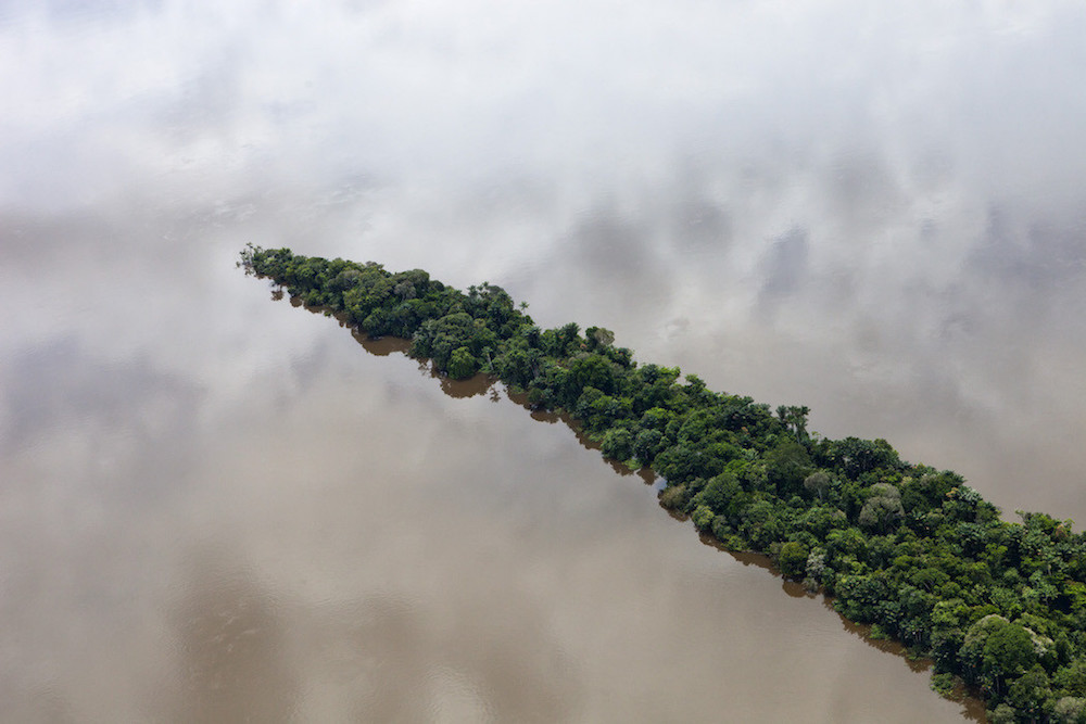Para, Brazil. February 11, 2012. Aerials south of Santarem and along the road BR163. Rainforest in the Tapajós River, coordinates: -4.737923-56.448047. Photo by Daniel Beltra for Greenpeace