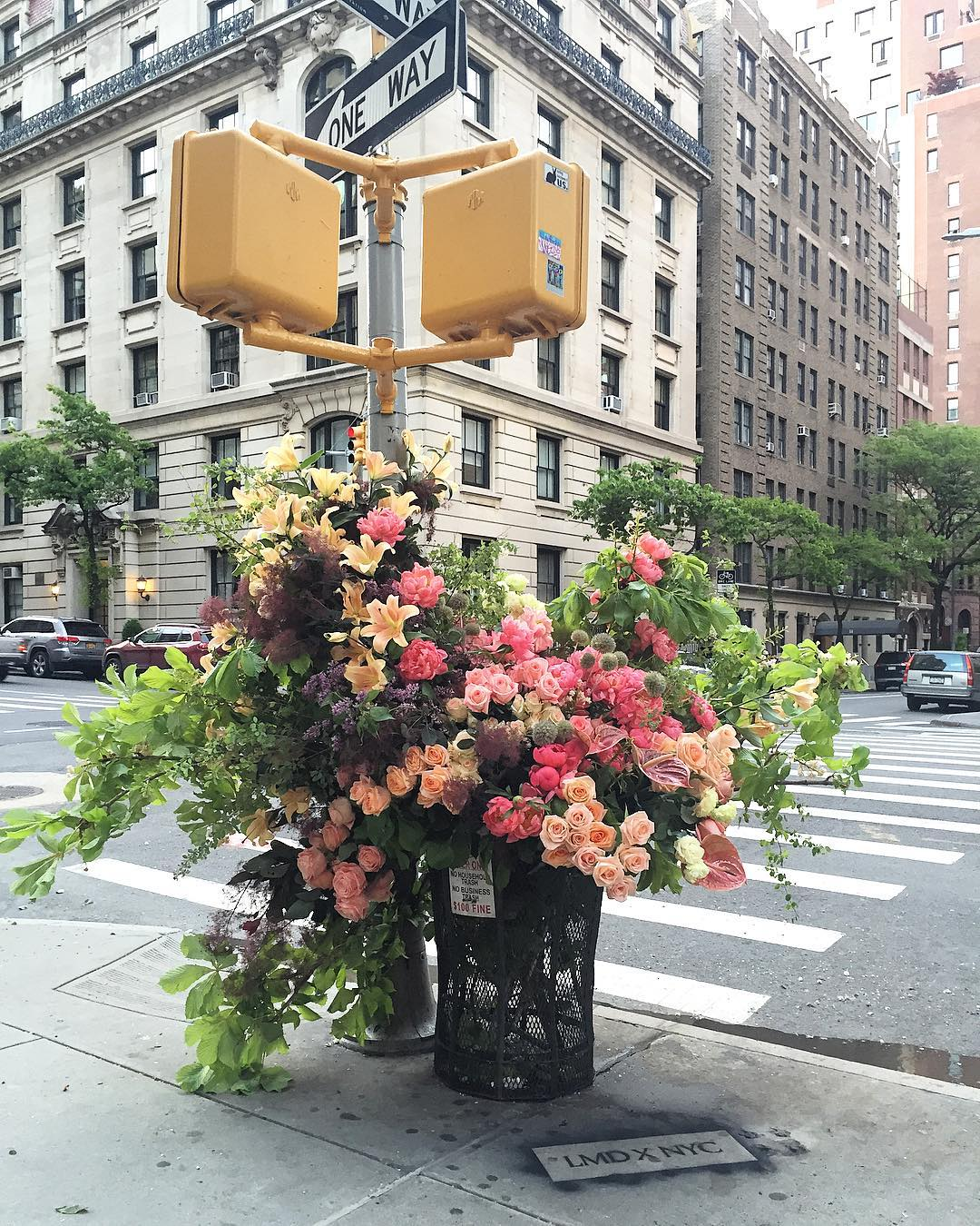 Image result for man in brussels fills up manholes with flowers