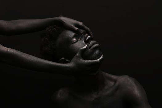 """Images from the series """"The Darkest Colour,"""" photographed by Yannis Davy Guibinga, featuring Tania Fines and Madjou Diallo, and with bodypainting by Jean Guy Leclerc. All images via Yannis Davy Guibinga."""