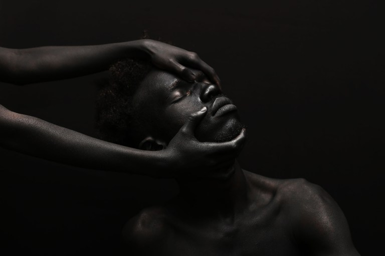 "Images from the series ""The Darkest Colour,"" photographed by Yannis Davy Guibinga, featuring Tania Fines and Madjou Diallo, and with bodypainting by Jean Guy Leclerc. All images via Yannis Davy Guibinga."