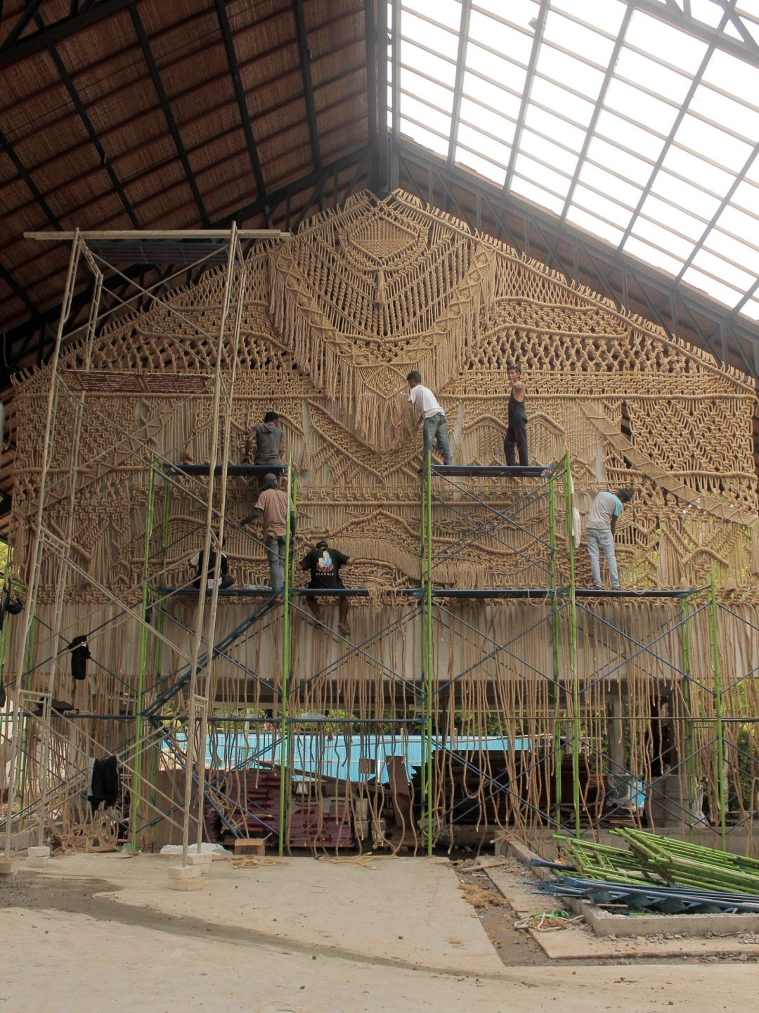 A Trio of Monumental Macramé Installations Stretch 37 Feet Across a Seaside Structure in Bali
