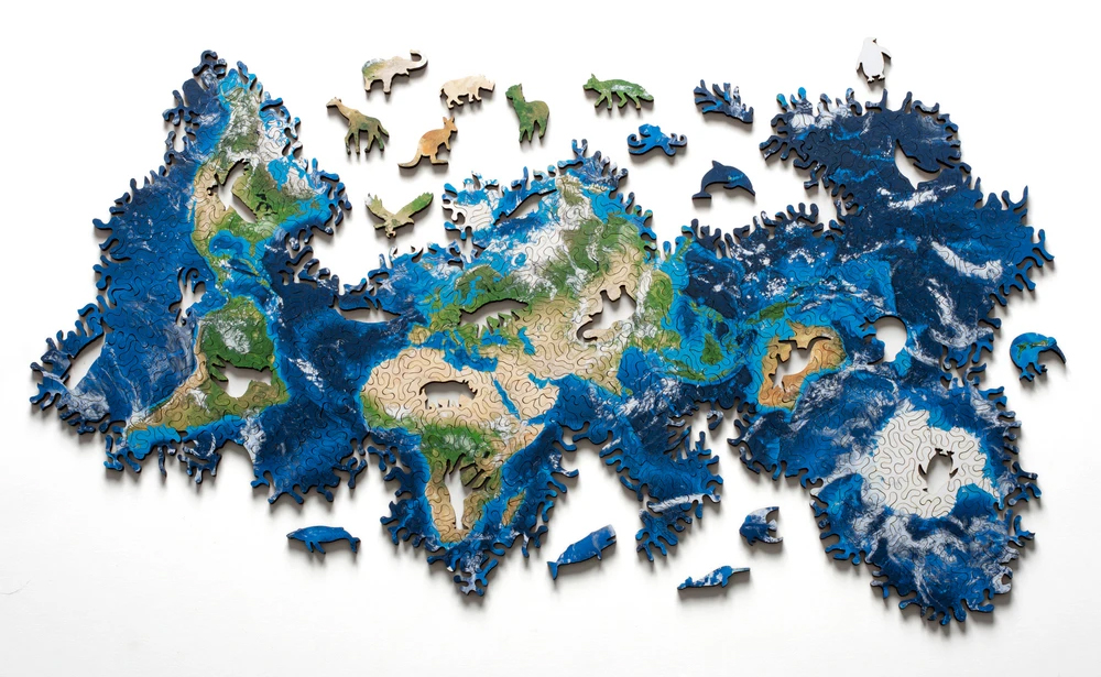 Piece Together the Geography of the Earth and Moon in Infinite Combinations with Nervous System's Jigsaw Puzzles