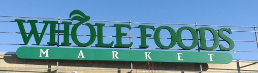Whole Foods Market sign on roof of store