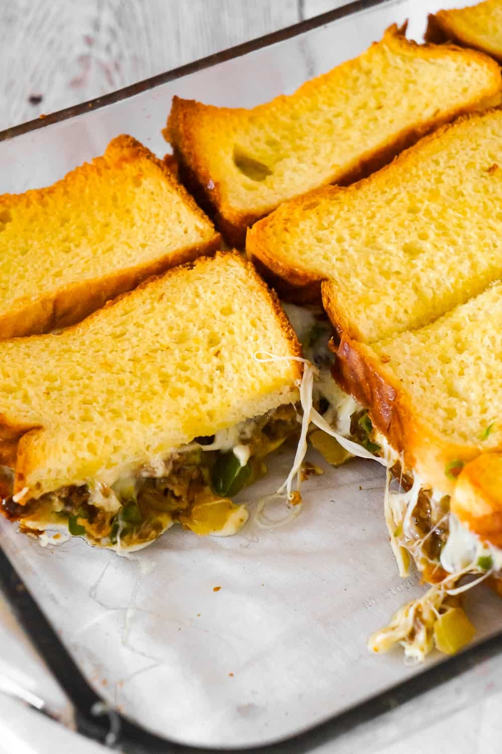 Philly Cheese Steak Grilled Cheese Casserole is a fun twist on a classic sandwich. This simple and delicious casserole is loaded with roast beef, green peppers, onions and oozing with mozzarella cheese.