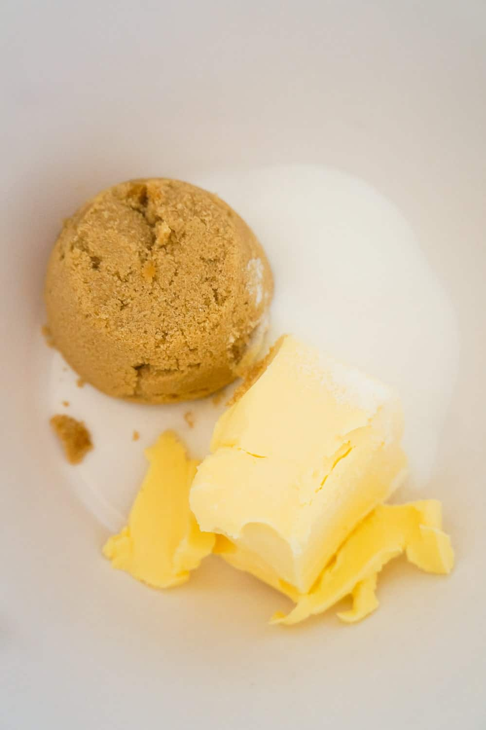butter flavoured Crisco, brown sugar and granulated sugar in a mixing bowl