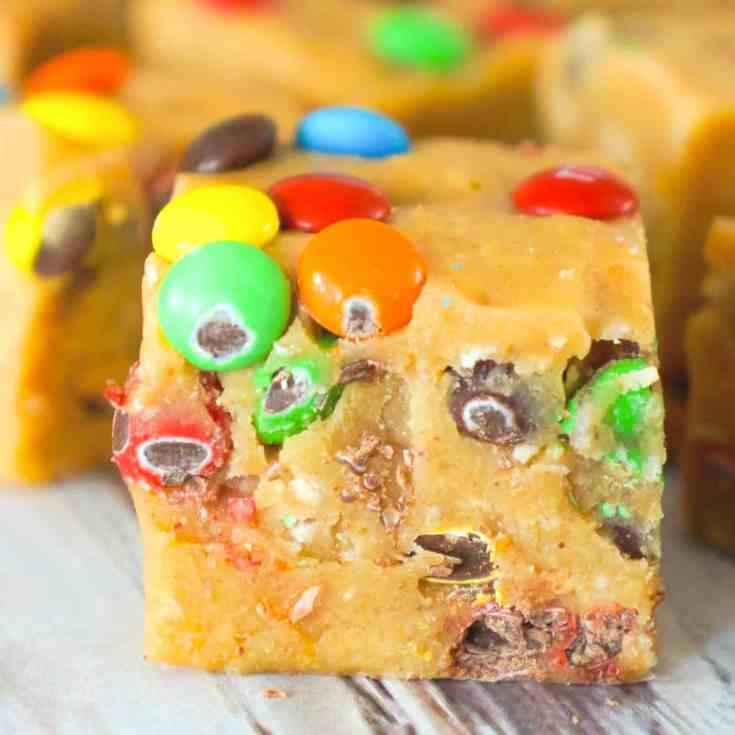 Monster Cookie Dough Fudge is an easy no bake microwave fudge recipe. This creamy fudge is made with peanut butter cookie dough mixed with Reese's peanut butter baking chips and condensed milk.