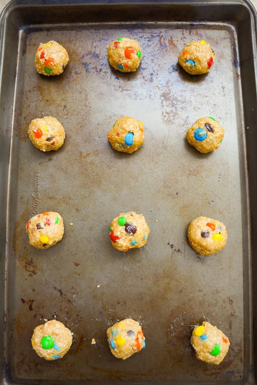 monster cookie dough balls on a baking sheet