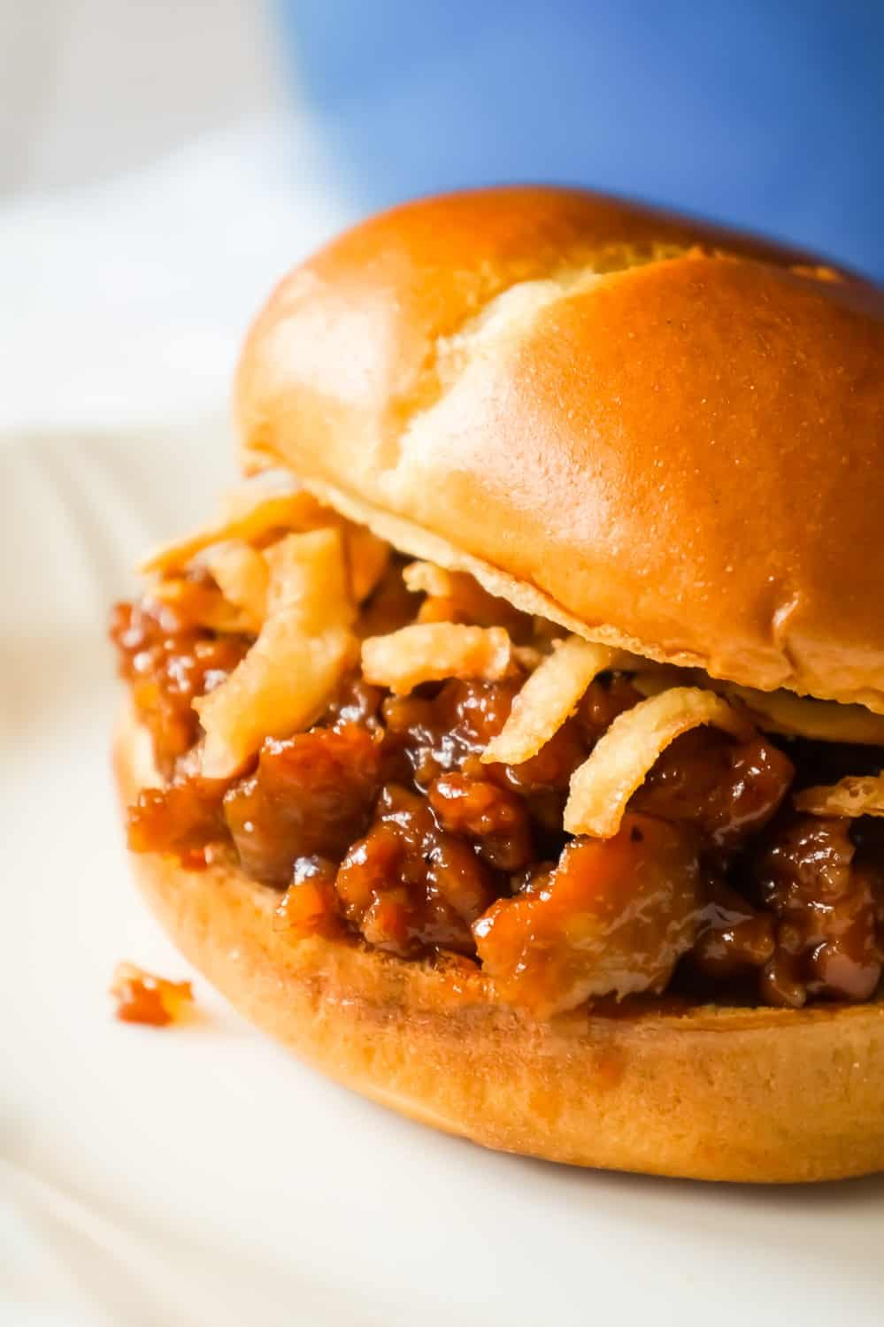 Dr Pepper Pork Sloppy Joes are an easy dinner recipe using ground pork sausage meat and diced onions cooked in Dr Pepper and BBQ sauce.