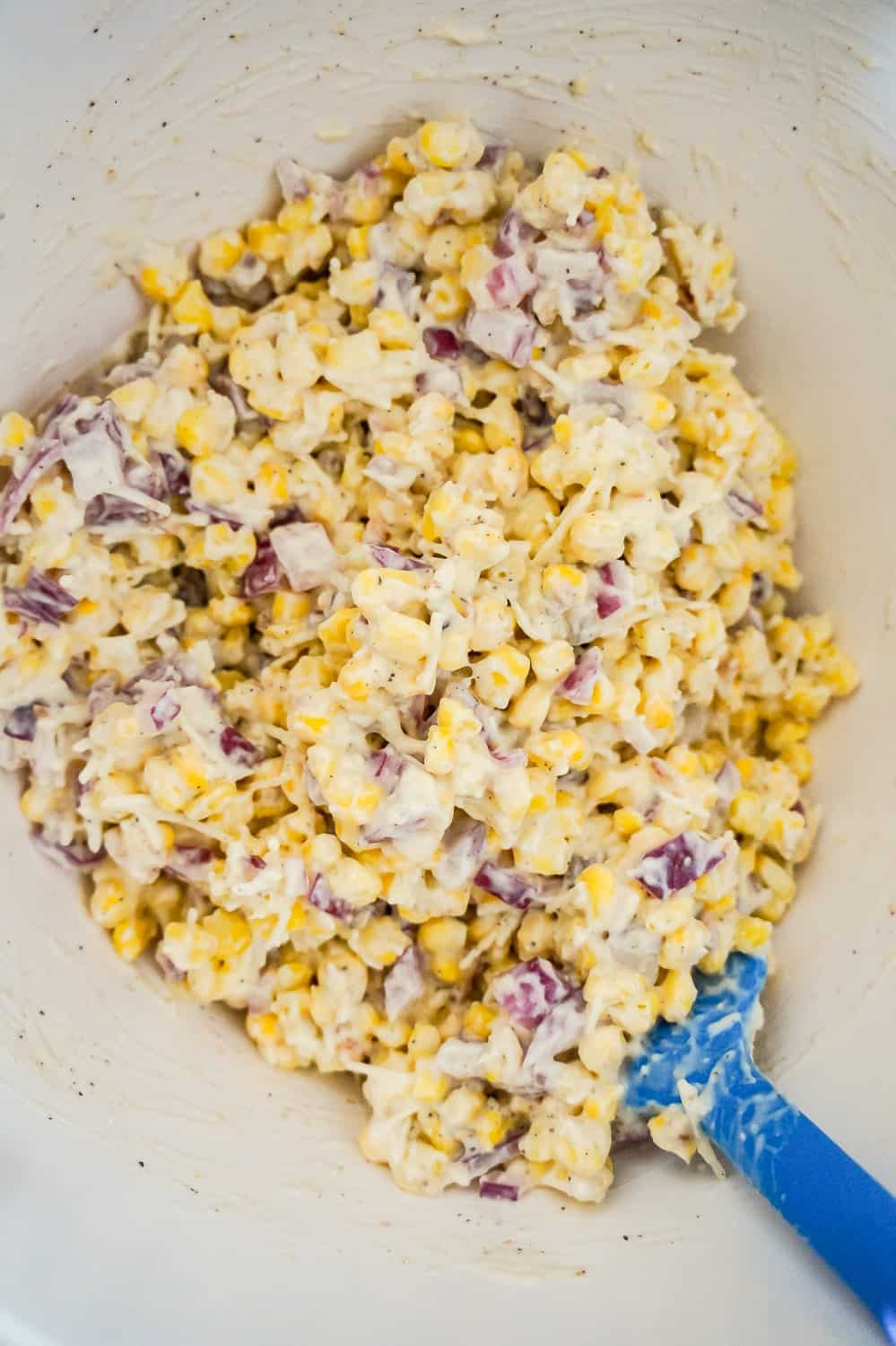 corn, red onions and cream soup mixture in a mixing bowl