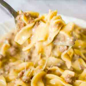 Instant Pot Cheesy Ground Beef and Noodles is an easy pressure cooker dinner recipe using hamburger meat and egg noodles loaded with mozzarella and cheddar cheese.
