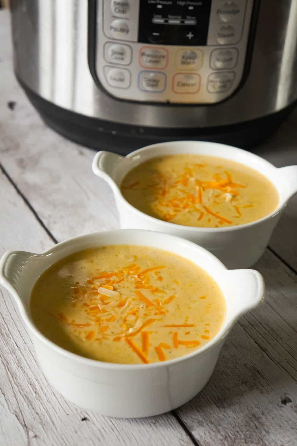 Instant Pot Broccoli Cheese Soup with Chicken is an easy pressure cooker soup recipe loaded with chunks of chicken, broccoli and cheddar cheese.