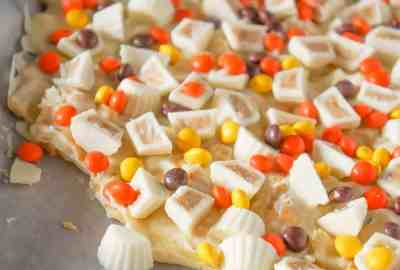 Fritos White Chocolate Peanut Butter Cup Bark is a sweet and salty dessert recipe made with white chocolate chips, Fritos corn chips, mini white chocolate Reese's peanut butter cups and mini Reese's pieces.